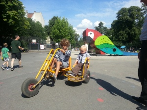 My son gets a ride in a Copenhagen playground - even the toys here promote cycle culture